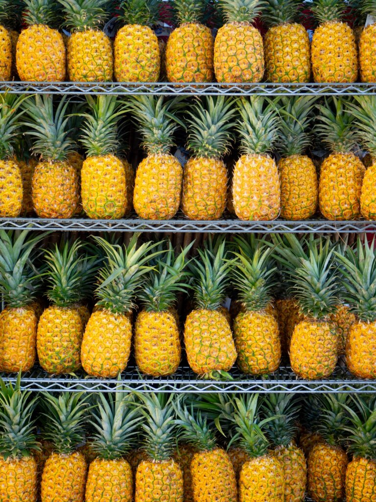 Countless ripe pineapples on shelves, waiting to be bought!