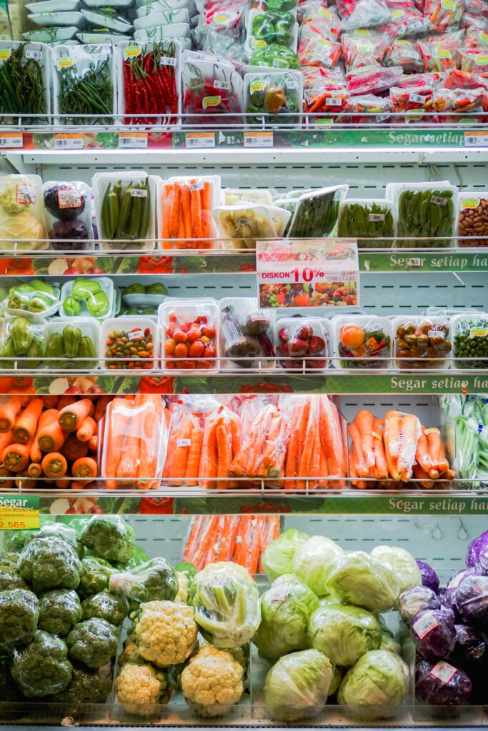 Colourful produce and vegetables in a grocery store cooler