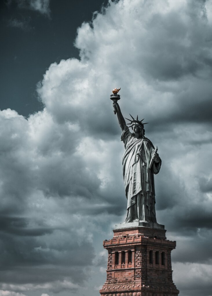 The Statue of Liberty on a cloudy day.