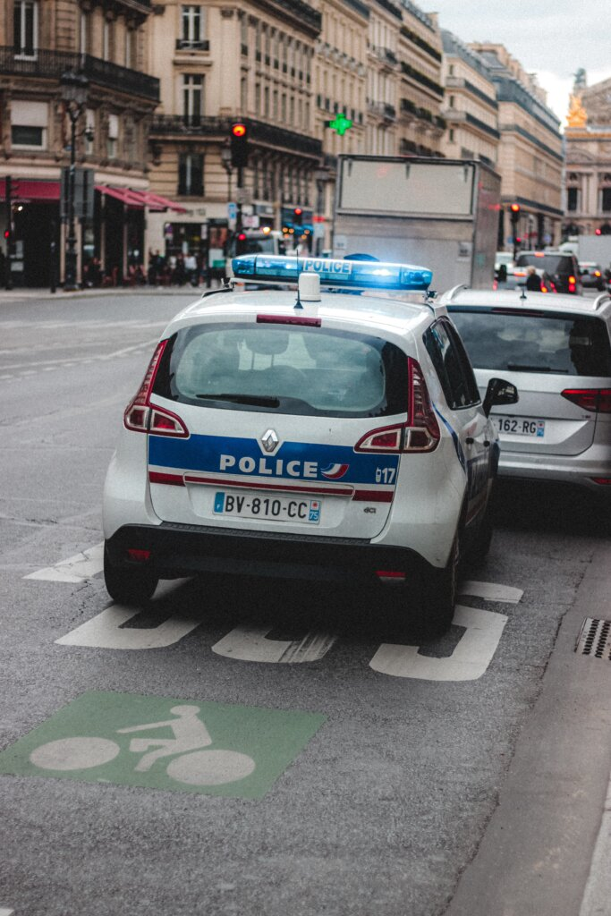 Police cars on the road in Paris