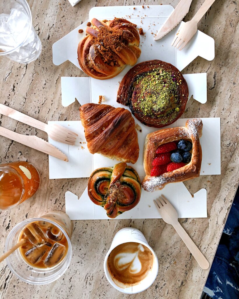 Picnic with coffees, croissants and pastries