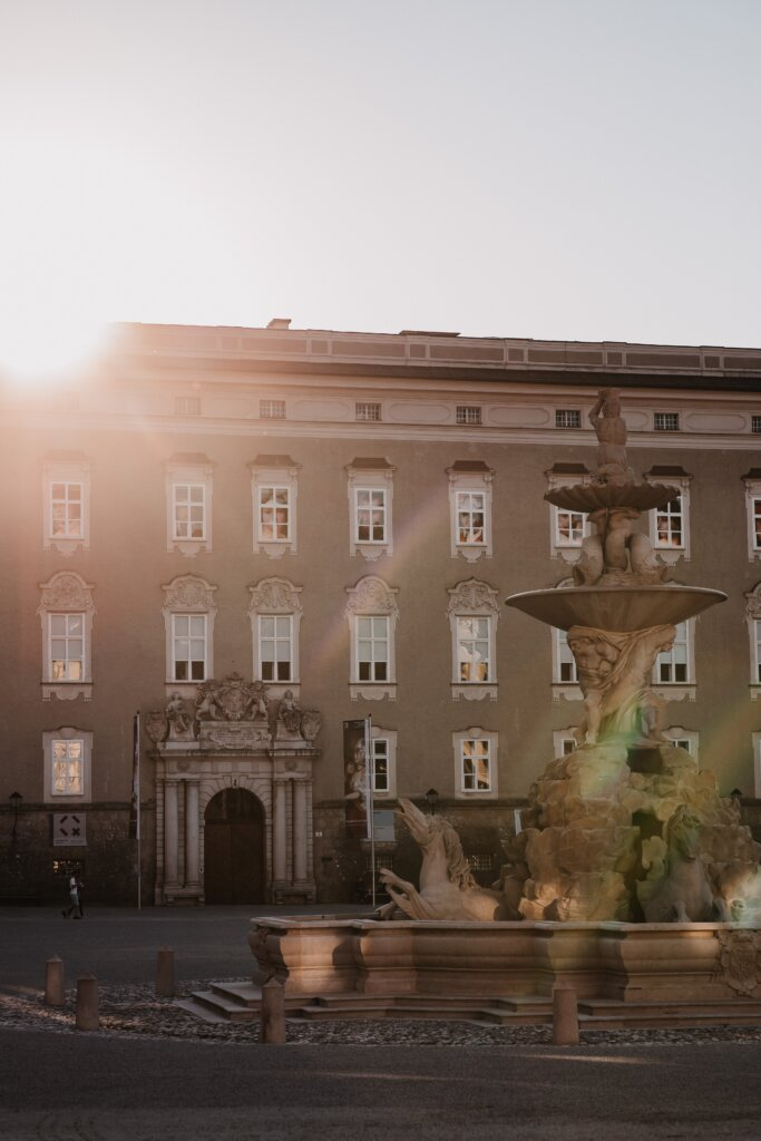 Ray of sunshine hitting fountain in Salzburg's Residenzplatz
