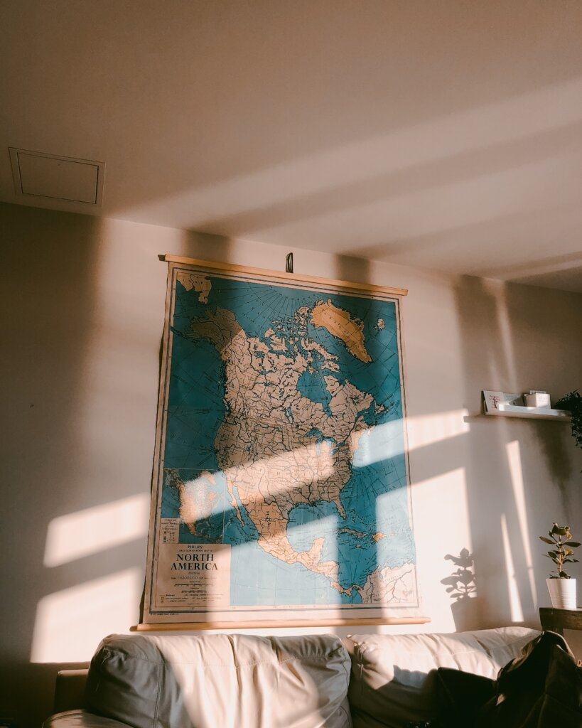 Large map on the wall with a sunray coming through the window