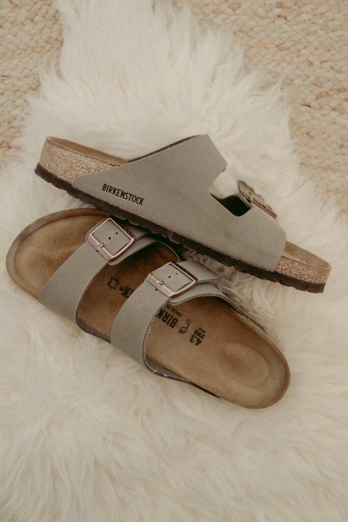 Birkenstock sandals on a rug