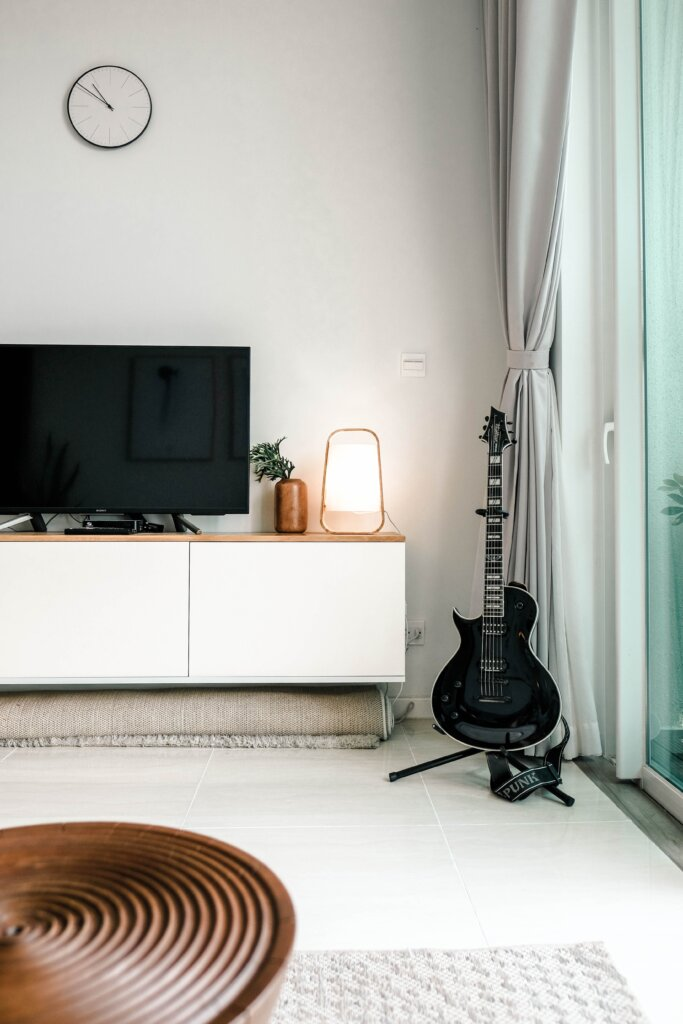 TV and guitar in a nice living space